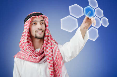 Young arab pressing virtual buttons Stock Photo - 13261497