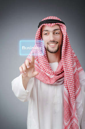 Young arab pressing virtual buttons Stock Photo - 13261167
