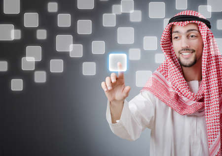 Young arab pressing virtual buttons Stock Photo - 13261048