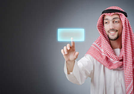 Young arab pressing virtual buttons Stock Photo - 13253696