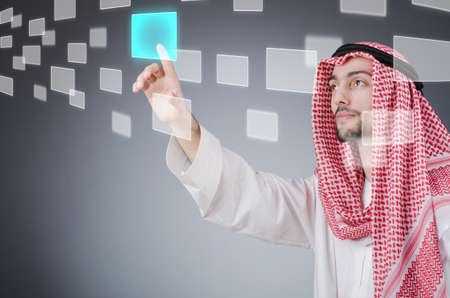 Young arab pressing virtual buttons Stock Photo - 13261281