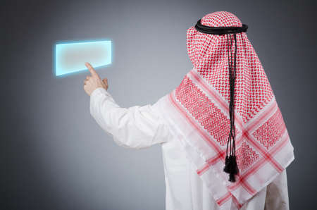 Young arab pressing virtual buttons Stock Photo - 13221410