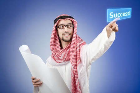 Young arab pressing virtual buttons Stock Photo - 13253703