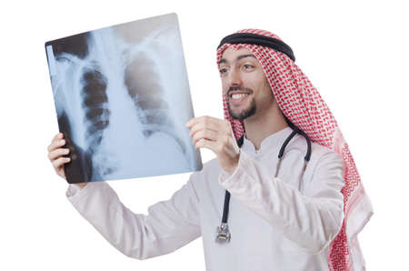 Arab doctor examining x-ray print photo