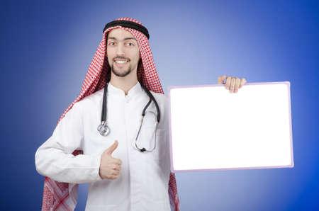 Arab Man with blank board photo
