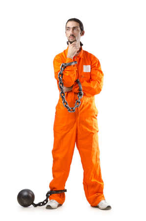 Criminal in orange robe in prison Stock Photo - 13253645