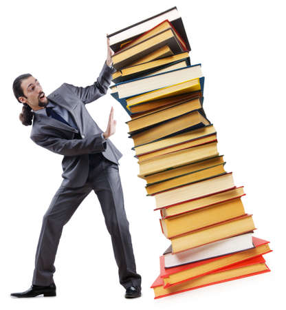 Businessman with books on white photo