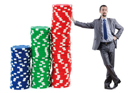 Businessman and casino chips on white Stock Photo - 13253656