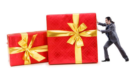 Businessman with gift boxes on white photo