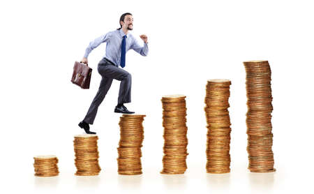 Businessman climbing gold coins stacks Stock Photo - 13260003