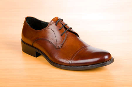 Brown shoes on wooden table