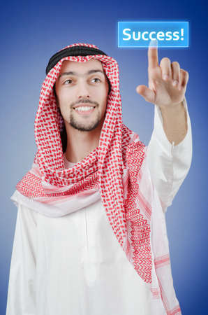 Young arab pressing virtual buttons Stock Photo - 13308860