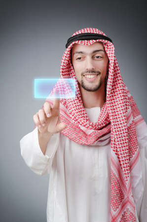 Young arab pressing virtual buttons Stock Photo - 13308903