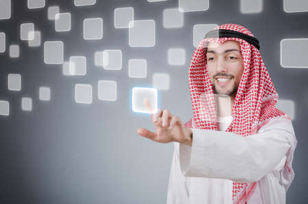 Young arab pressing virtual buttons Stock Photo - 13308899