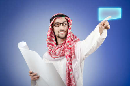 Young arab pressing virtual buttons Stock Photo - 13308855