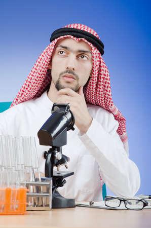 Arab chemist working in lab Stock Photo - 13308909