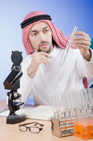 Arab chemist working in lab Stock Photo - 13308933