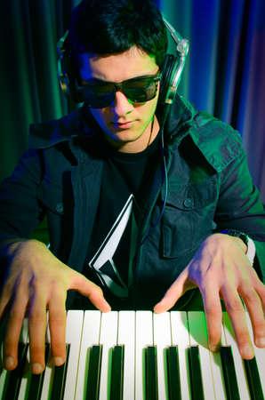 DJ mixing music at disco Stock Photo