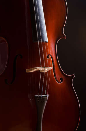 Music Cello in the dark room Stock Photo
