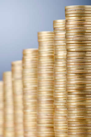 Golden coins in high stacks Stock Photo - 13303612