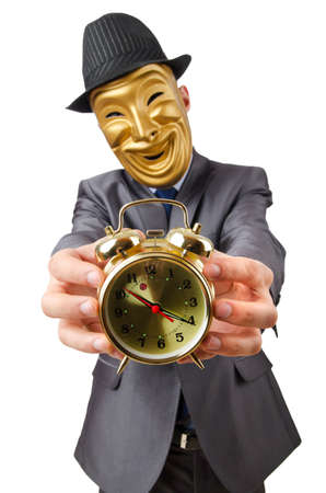 Masked man with clock on white Stock Photo - 13303899