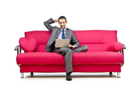 Man sitting in the sofa photo