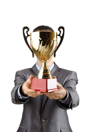 reward: Man being awarded with golden cup Stock Photo