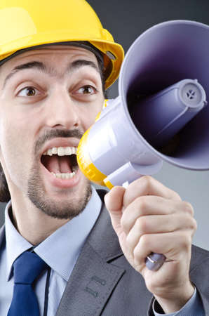 Man shouting and yelling with loudspeaker Stock Photo - 13643999