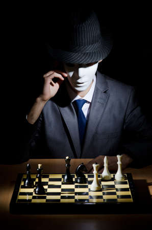battle plan: Chess player playing his game Stock Photo