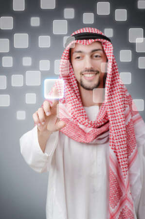 Young arab pressing virtual buttons Stock Photo - 13643876