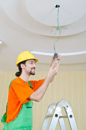 Electrician working on cabling lighting photo