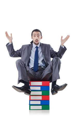 Businessman with many folders on white photo