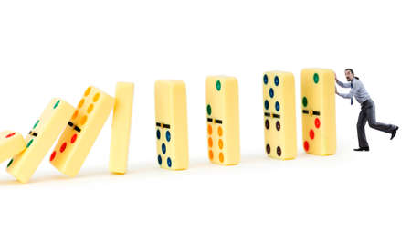Businessman and dominoes isolated on the white photo
