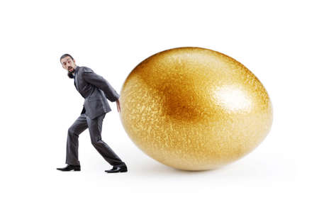 priceless: Man and golden egg isolated on white Stock Photo