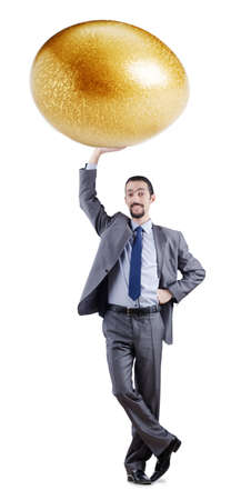 Man and golden egg isolated on white photo