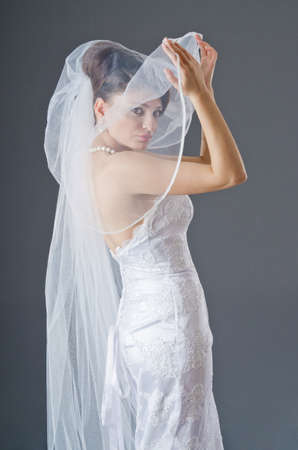 Bride in wedding dress in studio shooting Stock Photo - 13576402