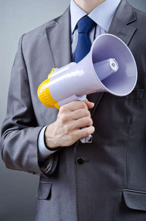Man shouting and yelling with loudspeaker Stock Photo - 13523387