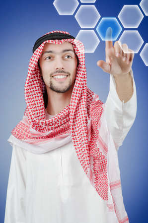 Young arab pressing virtual buttons Stock Photo - 13576455