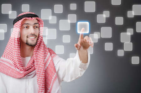 Young arab pressing virtual buttons photo