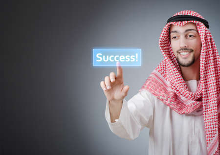 Young arab pressing virtual buttons Stock Photo - 13576385