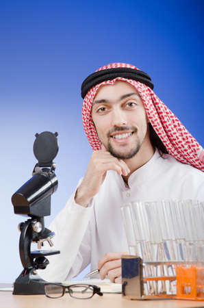 Arab chemist working in lab Stock Photo - 13576445