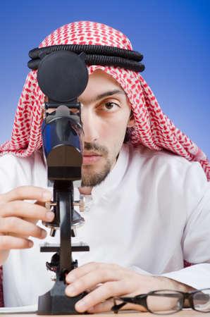 Arab chemist working in lab Stock Photo - 13576393