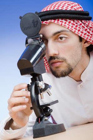 Arab chemist working in lab Stock Photo - 13576448