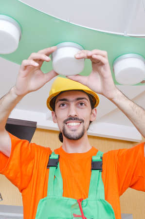 Electrician working on cabling lighting Stock Photo - 13576443
