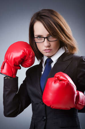 Young businesswoman in boxing concept Stock Photo - 13576357