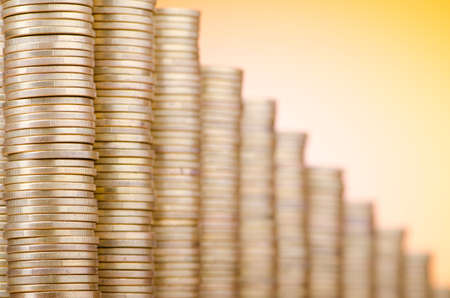 austerity: Golden coins in high stacks