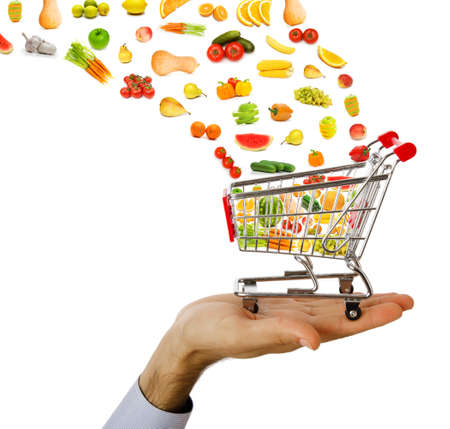 Los productos alimenticios de volar de carrito de la compra Foto de archivo
