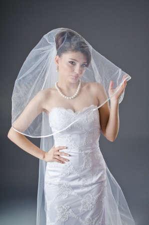 Braut im Hochzeitskleid in studio shooting