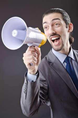 Man shouting and yelling with loudspeaker Stock Photo - 13597066