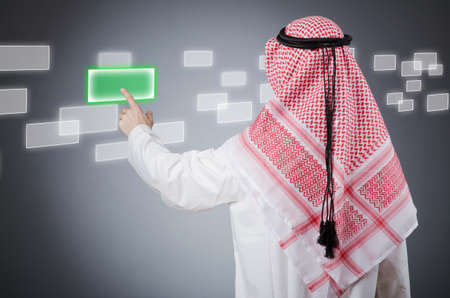 Young arab pressing virtual buttons Stock Photo - 13588986